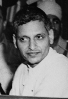 The triale of persons accused of participation and complicity in Mahatma Gandhi's assassination opened in the Special Court in Red Fort Delhi on May 27, 1948. A Close up of the accused persons. Left to right front row: Nathuram Vinayak Godse, Narayan Dattatraya Apte and Vishnu Ramkrishna Karkar. Seated behind are (from left to right) Diganber Ram Chandra Badge, Shankar s/o Kistayya, Vinayak Damodar Savarkar, Gopal Vinayak Godse and Dattatrays Sadashiv Parachure.